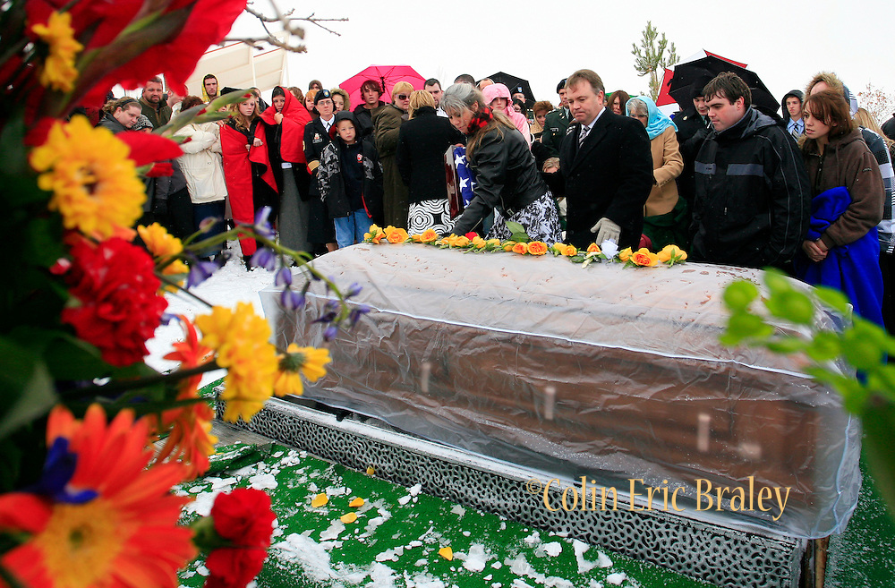 The family of Pfc. Aaron Nemelka take a final look at his casket at the end of a burial ceremony at Camp Williams, Saturday Nov. 14, 2009 in Riverton, Utah. Nemelka was one of 13 gunned down at Fort Hood, Texas. (AP Photo/Colin Braley)