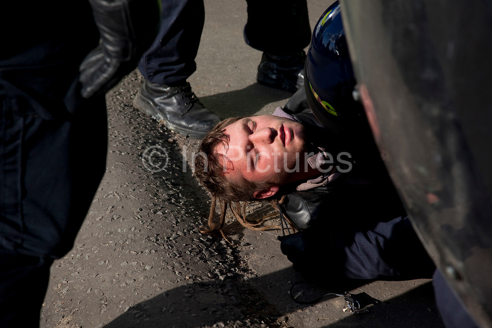 Riot police deal with a protester having been removed from the scaffolding structure. He seemed very shaky and distressed. The travellers were certain protesters were being tasered prior to arrest. Protesters who barricaded themselves above the entrance to the Dale Farm travellers' site have been removed by police as bailiffs prepare to move in. Essex Police cleared the scaffolding structure so it could be dismantled and machinery driven in by bailiffs to evict the travellers. On Wednesday night Essex Police said that over the course of the day 23 people had been arrested. Clearance of Dale Farm prior to eviction. Riot police and bailiffs were present on 19th October 2011, as a scaffolding gantry was cleared of protesters so the site could be cleared. Dale Farm is part of a Romany Gypsy and Irish Traveller site on Oak Lane in Crays Hill, Essex, United Kingdom. Dale Farm housed over 1,000 people, the largest Traveller concentration in the UK. The whole of the site is owned by residents and is located within the Green Belt. It is in two parts: in one, residents constructed buildings with planning permission to do so; in the other, residents were refused planning permission due to the green belt policy, and built on the site anyway.
