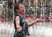 © Licensed to London News Pictures. 19/08/2012. London, UK Brody Daly aged 5 enjoys the water. Children play in the fountains at Granary Square in North London today. 1080 dancing jets of water make up the new fountain in its centre. Today is expected to be the hottest day of the year with temperature peaking at over 32 degrees celsius. Photo credit : Stephen Simpson/LNP