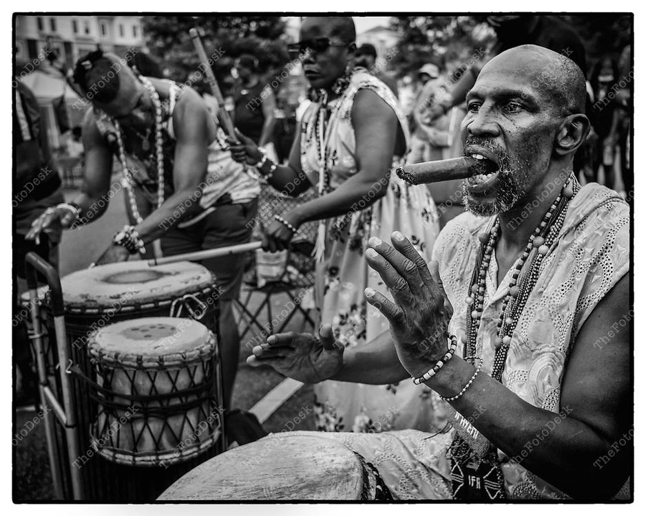 JERSEY CITY, NEW JERSEY:  Priest Fayemi Obadola Drummers feel the beat during the Jersey City House Music Festival at Lincoln Park, in Jersey City, NJ.  On Saturday, July 24, 2021. (Brian Branch-Price/TheFotodesk).