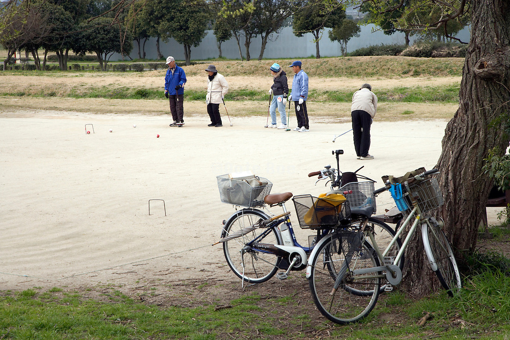 elderly people gathering for a game of croquet in Japan