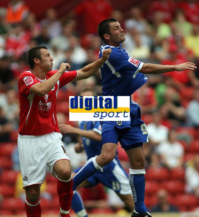 Photo: Rich Eaton.<br /> <br /> Barnsley v Cardiff City. Coca Cola Championship.<br /> <br /> 05/08/2006. Cardiff goalscorer #9 Steve Thompson rises above the Barnsley defence