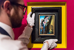 © Licensed to London News Pictures. 22/02/2018. LONDON, UK. A technician hangs ''Étude Pour 'Gradiva''' by Salvador Dalí, (Est. £60,000 - 80,000) at the preview of Sotheby's upcoming Impressionist, Modern & Surrealist Art auctions taking place at Sotheby's, New Bond Street, on 28 February. Photo credit: Stephen Chung/LNP
