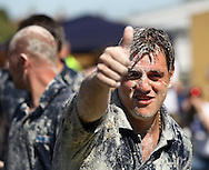 """Coxheath, Kent - Saturday, May 22nd 2010: Jimmy Hickmott, member of winning team """"The High Pressure Cleaning Company"""" at the World Custard Pie Championships at Coxheath near Maidstone, Kent. The first championship was held in 1967 in Coxheath using a special custard recipe developed by Richard Hearn aka Mr Pastry. The championship is made up of teams competing in heats, semi finals and the final, with the number of pies available per team increasing from 5 in the heats to 10 in the final. 6 points are scored for a direct hit on the face, 3 points for the shoulders or upwards, 1 point for any other part of the body, and points are deducted for misses. A discretionary 5 points can be awarded for the most amusing and original throwing technique. The event is part of the Rotary Club funday. (Pic by Andrew Tobin/SLIK Images)"""