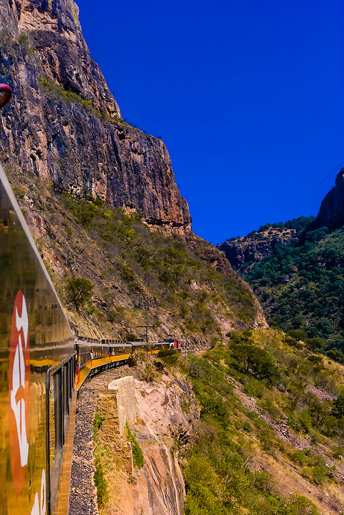 The CHEPE (Chihuahua al Pacifico railroad) train passing through Copper Canyon, Mexico