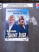 Defaced Front National poster in Paris, December 2015