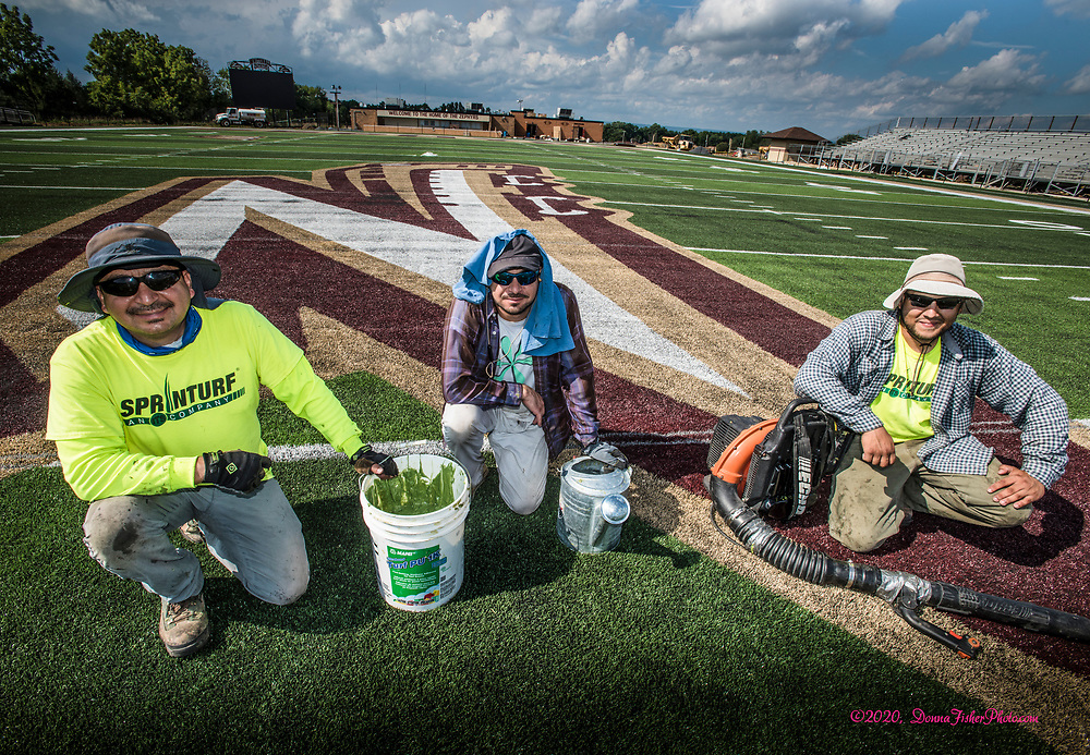 These workers have nearly completed installing the new field. The football field and sports complex at Whitehall High School are undergoing major renovations. The all-new football field is nearing completion along with improvements to the grandstands and a new press box.   Scenes along MacArthur Road in Whitehall Twp., Lehigh County, Pa.. Picture made August 17, 2020.<br />  Donna Fisher Photography, LLC