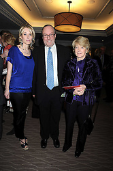 Left to right, LADY CLARE KERR and her parents MICHAEL ANCRAM MP (13th Marquess of Lothian) and the MARCHIONESS OF LOTHIAN at the Palace of Varieties in aid of Macmillan Cancer Support held at the InterContinental Hotel, Park Lane, London on 5th February 2009.