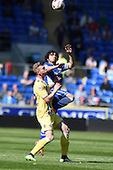 Fabio Da Silva of Cardiff city  jumps over Aiden O'Brien of Millwall to win a header. Skybet football league championship, Cardiff city v Millwall at the Cardiff city stadium in Cardiff, South Wales on Saturday 18th April 2015<br /> pic by Andrew Orchard, Andrew Orchard sports photography.