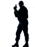 Full length of an alert afro American policeman standing with handgun on white isolated background