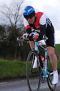 United Kingdom, Finchingfield, Mar 27, 2010:  Paul Sexton, Colchester Rovers CC, approaches the 4 miles to go marker during the 2010 edition of the 'Jim Perrin' Memorial Hardriders 25.5 mile Sporting TT promoted by Chelmer Cycling Club. Copyright 2010 Peter Horrell.