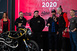 Pipeburn motorcycle blog founder Scott Hopkin giving out his award on stage for the Magazine Awards at Motor Bike Expo (MBE) bike show. Verona, Italy. Sunday, January 19, 2020. Photography ©2020 Michael Lichter.