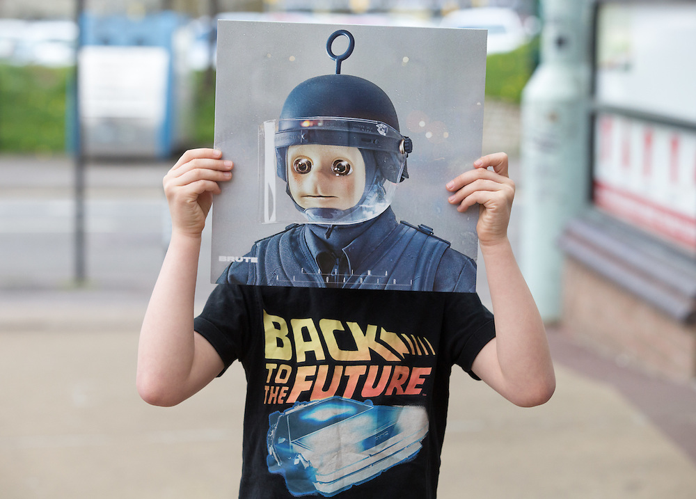 Record Store Day.  Strain MacDonald (7) from Scotstoun plays it for laughs with Brute by Fatima Al Qudiri outside Mono on King Street, Glasgow. His dad bought the album only for the cover (but he'll listen to it). Picture Robert Perry 16th April 2016<br /> <br /> Must credit photo to Robert Perry<br /> FEE PAYABLE FOR REPRO USE<br /> FEE PAYABLE FOR ALL INTERNET USE<br /> www.robertperry.co.uk<br /> <br /> NB -This image is not to be distributed without the prior consent of the copyright holder.<br /> in using this image you agree to abide by terms and conditions as stated in this caption.<br /> All monies payable to Robert Perry<br /> <br /> (PLEASE DO NOT REMOVE THIS CAPTION)<br /> This image is intended for Editorial use (e.g. news). Any commercial or promotional use requires additional clearance. <br /> Copyright 2016 All rights protected.<br /> first use only<br /> contact details<br /> Robert Perry     <br /> 07702 631 477<br /> robertperryphotos@gmail.com<br />        <br /> Robert Perry reserves the right to pursue unauthorised use of this image . If you violate my intellectual property you may be liable for  damages, loss of income, and profits you derive from the use of this image.