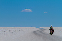 Salar de Uyuni is the world's largest salt flat at 10,582 square kilometers (4,086 sq mi). It is located in the Daniel Campos Province in Potosí in southwest Bolivia, near the crest of the Andes and is at an altitude of 3,656 meters (11,995 ft) above sea level.<br /> <br /> The Salar was formed as a result of transformations between several prehistoric lakes. It is covered by a few meters of salt crust, which has an extraordinary flatness with the average altitude variations within one meter over the entire area of the Salar. The crust serves as a source of salt and covers a pool of brine, which is exceptionally rich in lithium. It contains 50 to 70% of the world's lithium reserves, which is in the process of being extracted. The large area, clear skies, and exceptional flatness of the surface make the Salar an ideal object for calibrating the altimeters of Earth observation satellites. Biking Salar de Uyuni