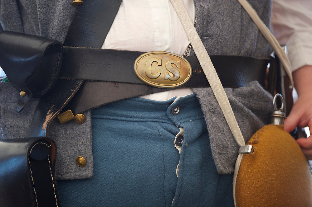A detail of a reenactor's belt as she listens to General Robert E. Lee during the 149th Gettysburg Reenactment in Gettysburg, Pennsylvania on July 6, 2012.