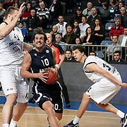 Anadolu Efes's Kerem TUNCERI (C) during their Turkish Airlines Euroleague Basketball Group C Game 6 match Anadolu Efes between Partizan at Sinan Erdem Arena in Istanbul, Turkey, Wednesday, November 23, 2011. Photo by TURKPIX