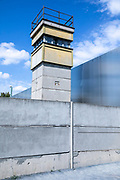 An East German guard tower at the Berlin Wall Memorial site along Bernauer street in Berlin, Germany, August 12, 2021. The order for the start of the construction of the Berlin wall was issued on 13 August, 1961. The barrier which consists of roughly 43 kilometer of concrete wall, watch towers, check-points, barbed wire and mines, creating a border strip separating the former Western Allies' enclave of West Berlin, from the rest of the city under DDR control. The wall stood until the 9th of November, 1989.
