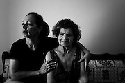 """Athens, Greece - Efi Demopolous, 57, unemployed, with her mum Maria, 83. She recently moved back from Brazil, where she was born, to assist her mum. Maria's retirement salary is € 425/month and house rent is € 350/month. Maria says their condition is so difficult that sometimes she thinks she would rather die than carry on like that. Greek economical crisis started in 2008. The so-called Austerity measures imposed to the country by the """"Troika"""" (European Union, European Central Bank, and International Monetary Fund) to reduce its debt, were followed by a deep recession and the worsening of life conditions for millions of people. Unemployment rate grew from 8.5% in 2008 to 25% in 2012 (source: Hellenic Statistical Authority).<br /> Bruno Simões Castanheira"""
