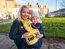 Pictured: Kelly & isla Thompson - wife & daughter of Owen Thomson.<br /> <br /> Loanhead, Midlothian, Scotland, United Kingdom, 18 November 2019. General Election campaigning:  SNP Depute Leader Keith Brown MSP joins Owen Thomson, SNP candidate for Midlothian, on the campaign trail at Fountain Green, Loanhead. <br /> Sally Anderson | EdinburghElitemedia.co.uk