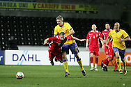 Andrew Crofts of Wales (16) is tackled by Pontus Wernbloom of Sweden.International friendly, Wales v Sweden at the Liberty Stadium in Swansea on Wed 3rd March 2010. pic  by  Andrew Orchard