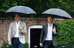 The Duke of Cambridge and Prince Harry arrive for a visit to the White Garden in Kensington Palace, London, and to meet with representatives from charities supported by Diana, the Princess of Wales.
