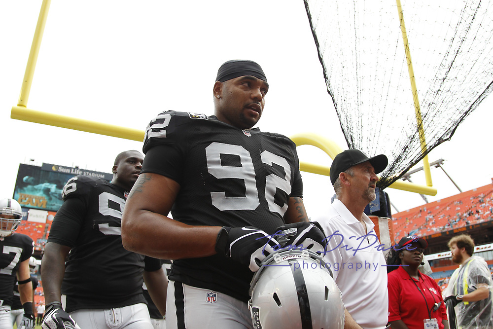 Oakland Raiders Richard Seymour during an NFL football game against the Miami Dolphins on September 16, 2012 in Miami, FL at Sun Life Stadium.<br /> (Photo/Tom DiPace)