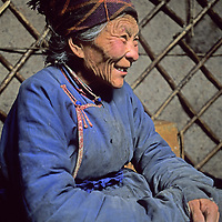 MONGOLIA, Darhad Valley. Darsuran (70), shortly before beginning ten-day trek on foot with her sheep over snowbound mts.