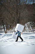 Local boy playing with boxes in Komsomolsk-on-Amur. Siberia, Russia