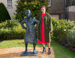 © Licensed to London News Pictures; 04/10/2021; Bristol, UK. Artist HELEN WILSON-ROE stands next to her statue of Henrietta Lacks after it was unveiled by members of the Lacks family from the USA. The first public sculpture of a black woman made by a black woman in the UK is unveiled at the University of Bristol's Royal Fort Gardens. Bristol artist Helen Wilson-Roe created the life-sized bronze statue of Henrietta Lacks whose cancer cells changed the course of modern medicine. Cells were taken from Henrietta without her consent or knowledge and were the first living human cells to ever survive and multiply outside the body.The statue's unveiling marks the 70th anniversary of Henrietta's death. Photo credit: Simon Chapman/LNP.