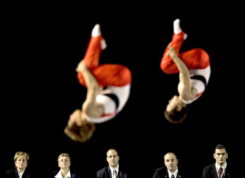 The Netherlands, Eindhoven, 17-09-2005.<br /> Gymnastics. World championships trampoline.<br /> The members of the jury are looking at the japanse duo, Tetsuya Sotomura en Yasuhiro Ueyama, during their performance in the duo jump.<br /> Photo: Klaas Jan van der Weij.