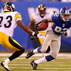 21 Aug, 2010: New York Giants wide receiver Mario Manningham (82) evades Pittsburgh Steelers cornerback Keenan Lewis (23) during first half NFL preseason action between the New York Giants and Pittsburgh Steelers at New Meadowlands Stadium in East Rutherford, New Jersey.
