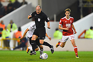Referee Scott Duncan jumps over the ball during the EFL Sky Bet Championship match between Nottingham Forest and Fulham at the City Ground, Nottingham, England on 26 September 2017. Photo by Jon Hobley.