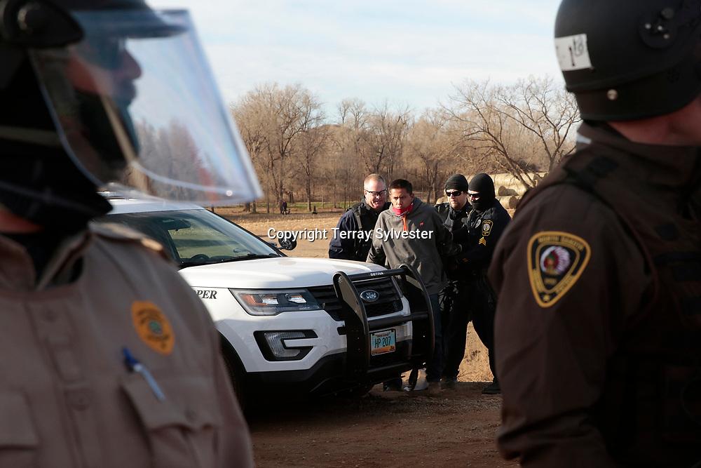 Police arrest an opponent of the Dakota Access oil pipeline on November 15, 2016. Mandan, North Dakota, United States.