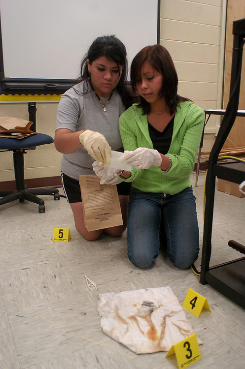 Brownsville, TX January, 2006:  Students in Lopez' Law Enforcement Academy gather evidence in an actual break-in at the school where thousands of dollars of computer equipment were stolen. <br /> ©Bob Daemmrich/