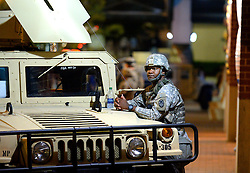 September 23, 2016 - Charlotte, NC, USA - A National Guard soldier watches foot traffic pass by on Trade Street in Charlotte, N.C., on Friday, Sept. 23, 2016, as demonstrations continue following the shooting death of Keith Scott by police earlier in the week. (Credit Image: © Jeff Siner/TNS via ZUMA Wire)