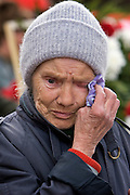 Moscow, Russia, 07/05/2005..Russia celebrates the 60th anniversary of the end Second World War, generally referred to in Russia as the Great Patriotic War. An old woman weeps as she lays flowers at the Tomb Of The Unknown Soldier..