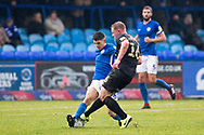 Mansfield Town midfielder Willem Tomlinson challenged by Macclesfield Town midfielder Connor Kirby  during the EFL Sky Bet League 2 match between Macclesfield Town and Mansfield Town at Moss Rose, Macclesfield, United Kingdom on 16 November 2019.