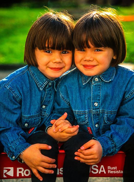 Four year old Portuguese-American twin girls, Danbury, Connecticut USA.