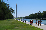 WASHINGTON - JUNE 30, 2019: Visitors gather near the Lincoln Memorial Reflecting Pool on June 30, 2019, in Washington, D.C.