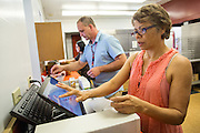 Milpitas Unified School District Transportation, Grounds, Plumbing, and Safety Supervisor Roger Silveira shadows Rancho Middle School Satellite Kitchen Operator Idalia Campos during Classified School Employee Week at Rancho Middle School in Milpitas, California, on May 19, 2016. (Stan Olszewski/SOSKIphoto)