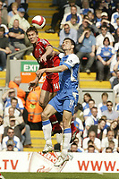 Photo: Aidan Ellis.<br /> Liverpool v Wigan Athletic. The Barclays Premiership. 21/04/2007.<br /> Liverpool's Daniel Agger beats Wigan's Paul Scharner to the ball