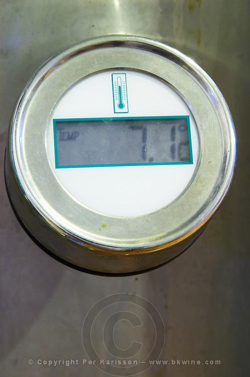 Fermentation tanks. Thermometer showing 7.1 Centigrade. Henrque HM Uva, Herdade da Mingorra, Alentejo, Portugal