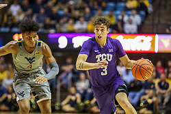 Jan 14, 2020; Morgantown, West Virginia, USA; TCU Horned Frogs guard Francisco Farabello (3) drives past West Virginia Mountaineers guard Miles McBride (4) during the first half at WVU Coliseum. Mandatory Credit: Ben Queen-USA TODAY Sports