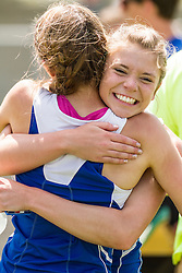 Maine State Track & Field Meet, Class B: girls 400 meters, Kaitlin Saulter, Hermon, state record 56.95, congratulated by team mate