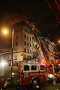 Atmosphere at Seven Alarm Fire at 283 Grand Ave and Eldrige Streets , where at least six Fire Fighters, and three civilians were hurt in the late sunday night blaze which engulfed three building and sending residents out into the night for safety on April 11, 2010 in New York City.