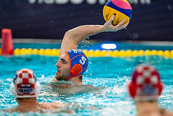 Guus van IJperen of the Netherlands in action against Croatia during the Olympic qualifying tournament. The Dutch water polo players are on the hunt for a starting ticket for the Olympic Games on February 15, 2021 in Rotterdam