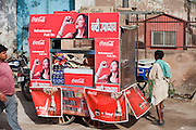 A vendor is selling Coca Cola on the streets of Agra. The Taj Mahal has been struggling to keep in shape also because of the high levels of pollution in the city, mainly caused by congested roads and high levels of traffic, vehicles and an increasing population, in Agra.