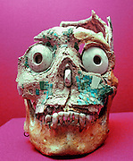 MEXICO, MIXTEC CULTURES human skull, inlaid with shell and turquoise from a tomb near the city of Oaxaca