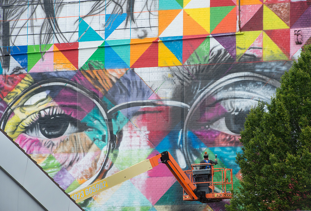 © Licensed to London News Pictures.  28/07/2017; Bristol, UK. Upfest 2017. An artist spay paints a giant mural on the side of the Tobacco Factory for Upfest, Europe's largest street art festival held annually in Bedminster, Bristol. The festival officially runs from 29 - 31 July with over 350 artists live painting in 37 locations including this Ashton Gate stadium, home of Bristol City FC. Picture credit : Simon Chapman/LNP