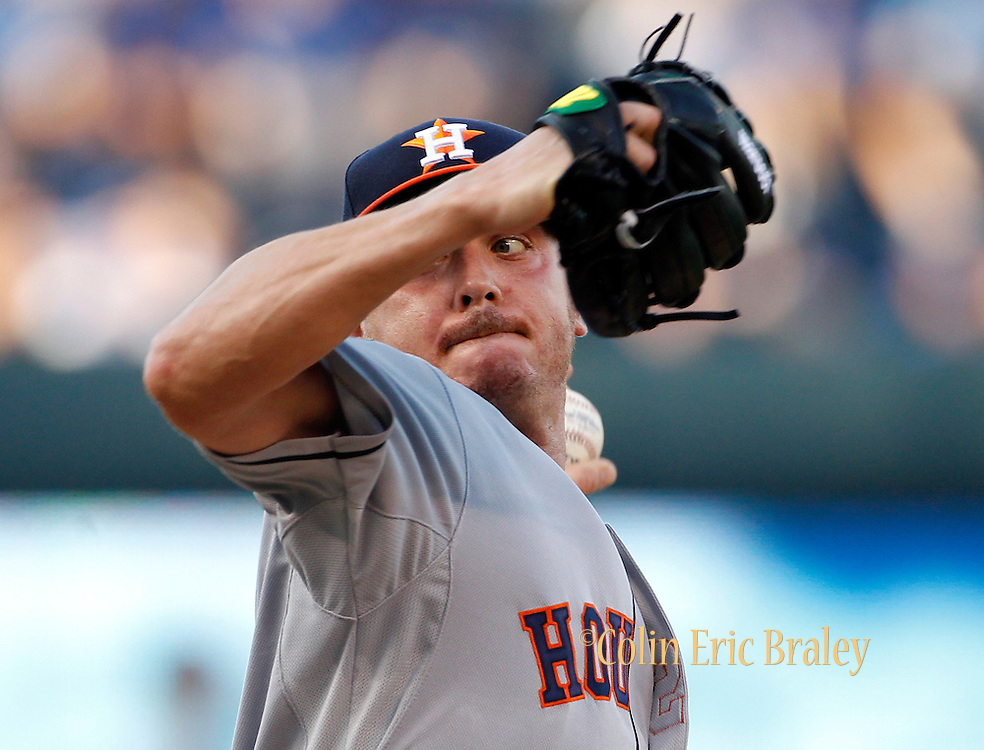 Houston Astros pitcher Scott Kazmir throws in the first inning of a baseball game against the Kansas City Royals at Kauffman Stadium in Kansas City, Mo., Friday, July 24, 2015. Kazmir is starting in his first game for Houston after being traded this week by the Oakland Athletics. (AP Photo/Colin E. Braley)
